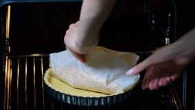 A woman baking a crust for a tart. stock video footage