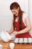 Woman baking cupcakes Stock Image