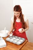 Woman baking cupcakes Royalty Free Stock Image