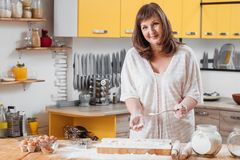 Woman baking hands flour home hobby courses. Middle aged woman baking. Content smiling female hands in flour dust. Home baked foods goods hobby. Culinary courses royalty free stock photography