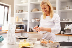 Woman baking at home Stock Image