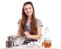 Woman baking at home following recipe Stock Photography