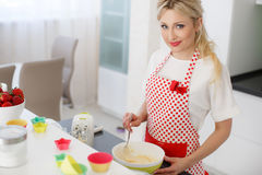 Woman baking at home. Royalty Free Stock Photography
