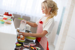 Woman baking at home. Stock Photos