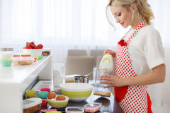 Woman baking at home. Royalty Free Stock Photo