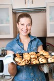 The woman with baking hot rolls Stock Photos