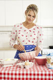 Woman Baking In Kitchen Stock Photo