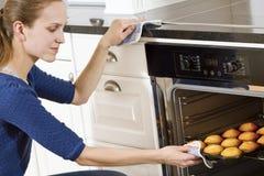 Woman Baking Muffins Stock Photography