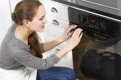 Woman Baking Muffins Stock Photos