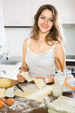 Woman baking something of dough Royalty Free Stock Photography