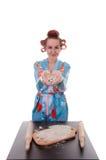 Woman baking in studio Royalty Free Stock Image