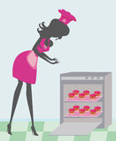 Woman baking sweet muffins Royalty Free Stock Photography