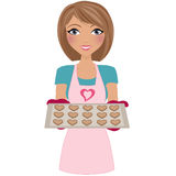 Woman baking valentine cookies Stock Images