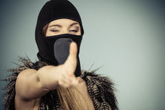 Woman in balaclava gun gesture, crime and violence Royalty Free Stock Photography