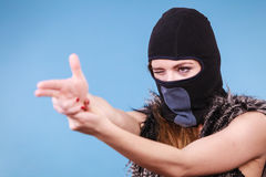 Woman in balaclava gun gesture, crime and violence Stock Images