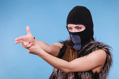 Woman in balaclava gun gesture, crime and violence Royalty Free Stock Image