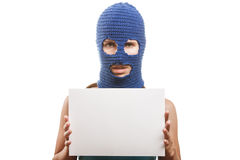 Woman in balaclava holding blank card Stock Photography