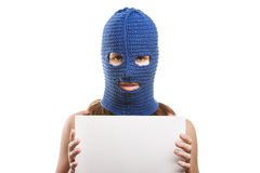 Woman in balaclava holding blank card Stock Photos