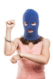 Woman in balaclava showing handcuffs on hands Royalty Free Stock Image