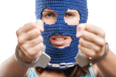 Woman in balaclava showing handcuffs on hands Stock Photos