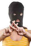 Woman in balaclava showing jail or prison finger Stock Photo