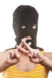 Woman in balaclava showing prison gesture Royalty Free Stock Images