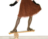 Woman on balance board Royalty Free Stock Image