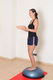 Woman balance training Stock Image