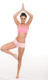 Woman balanced in a yoga pose Stock Image
