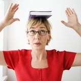 Woman balancing book. Royalty Free Stock Images