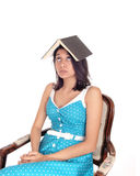 Woman balancing book on head. Stock Photography