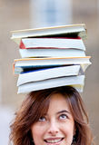 Woman balancing books Royalty Free Stock Images