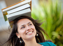 Woman balancing books Royalty Free Stock Photo