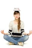 Woman balancing books on head Stock Images