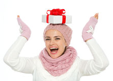 Woman balancing Christmas present box on head Stock Images