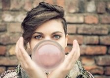 Woman balancing crystal ball Stock Photo