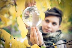 Woman balancing crystal ball Royalty Free Stock Photography