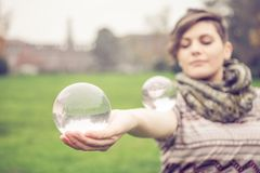 Woman balancing crystal ball Stock Photography