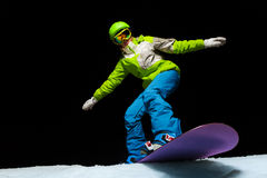 Woman balancing with hands on snowboard Royalty Free Stock Photos
