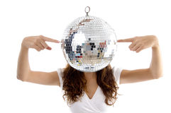 Woman balancing mirror ball with fingers Royalty Free Stock Photography