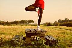 Woman balancing on picnic table