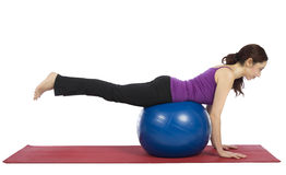 Woman balancing on pilates ball royalty free stock photos