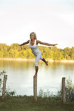 Woman balancing on a post stock images