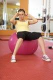 Woman Balancing On Swiss Ball Stock Images