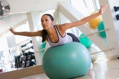Woman Balancing On Swiss Ball royalty free stock images