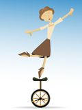 Woman balancing on tippy toes on unicycle Royalty Free Stock Image