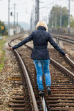 Woman balancing on track. decisions Stock Images