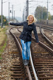 Woman balancing on track. decisions Royalty Free Stock Images