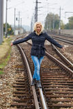 Woman balancing on track. decisions Stock Photo