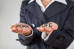 Woman balancing work and private life Royalty Free Stock Photos